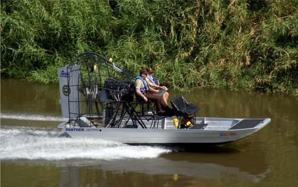 Yuma County Sheriff's Office Lt. Darren Simmons, right, and Major Leon Wilmot, ply the waters of the lower Colorado River. They were demonstrating the department's new Airboat which enables them to pass over water as shallow as a few inches. The new boat will enhance their ability to enforce boating and other laws on a part of the river that is sometimes difficult to reach with other types of watercraft. photo: Terry Ketron