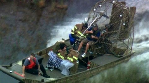 Ohio family returning on their airboat after having been missing in the Everglades for 24hrs.
