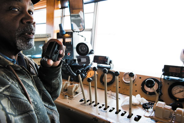 Samuel Mosby operating the dredge Butcher, which draws silt from Lake Borgne to restore the nearby marshland.