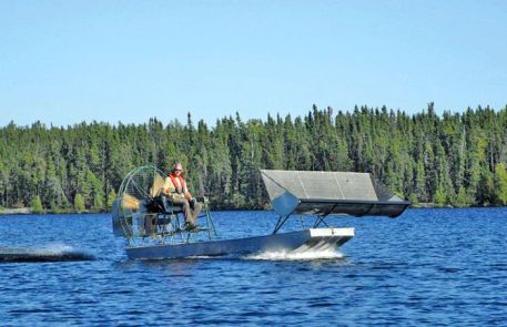 Bob Anderson pilots an airboat equipped with a hopper.