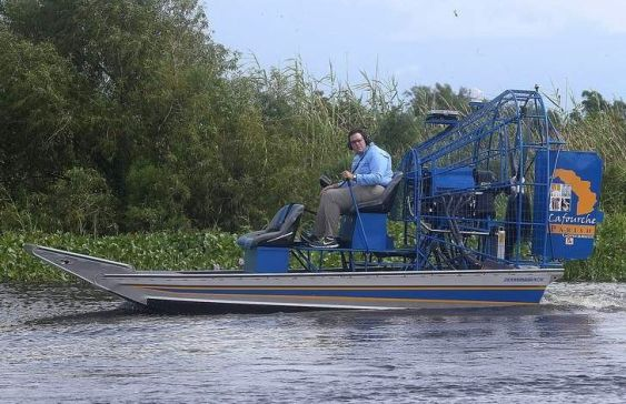 Lafourche Parish administrator Archie Chaisson drives an airboat Thursday after looking over a marsh terracing project in marshland in south Lafourche.