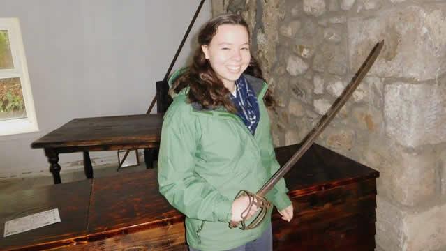Rachel holding swordslider