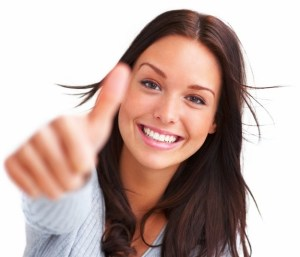 Portrait of attractive young woman showing a thumbs up on white background