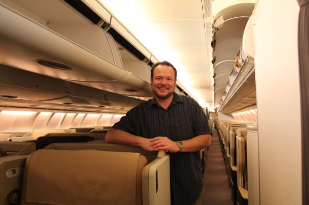 All aboard! Okay, I am cheating a bit here. This is a photo of me on the LAX-SIN A340-500, but you get the idea. Today my shirt is blue.