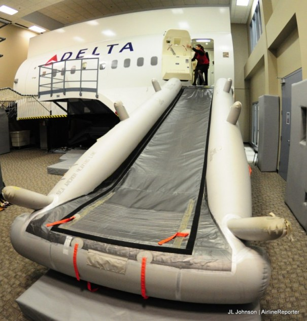 Delta's evacuation trainer, hopefully you never have to use it for real (well the trainer yes, but in a real accident, no). If things get bad, always stay calm and follow instructions. That will more likely safe you than your seat assignment.