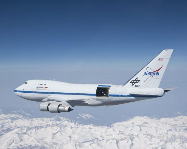 With the sliding door over its 17-ton infrared telescope wide open, NASA's Stratospheric Observatory for Infrared Astronomy – or SOFIA – soars over California's snow-covered Southern Sierras on a test flight in 2010 - Photo: NASA