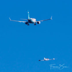 The MAX 7 and a T-33 chase plane head north over Lake Washington.