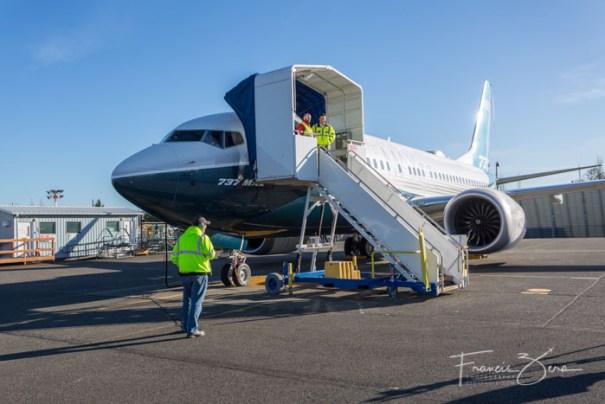 Crews prepare the jet for departure.