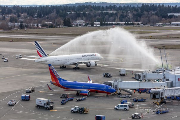The jet also received a water-cannon salute as it left the terminal on the return flight to Paris