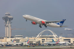 An SAS A330 departing from LAX with the iconic Theme Building and control tower, as seen from the Imperial Hill viewpoint.