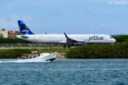 "Jetblue flight 557 to JFK carried by N972JT, an A321. This plane carries the name ""Just Plane Blue."""