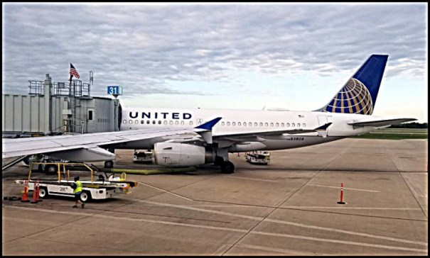 United A319 under slightly overcast skies in Austin