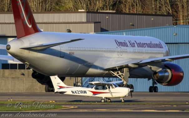 The Cessna 172 feels reasonably big until you taxi past a 767. Photo by Dave Honan