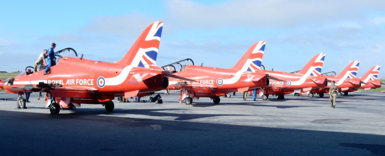 Four Red Arrows Hawks lined up at YVR, including Red 5 flown by Squadron Leader Steve Morris.