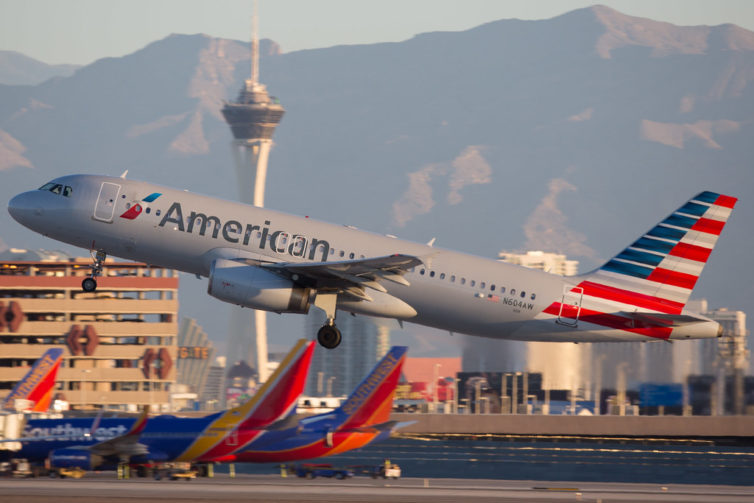 An American A-320 Departs LAS with Southwest in the background. - Photo: Jeremy Dwyer-Lindgren