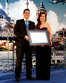"""Pictured at the certification ceremony of Enfidha-Hammamet International Airport are Mr. Ali Tounsi (Secretary General, ACI AFRICA) presenting the """"Mapping"""" certificate to Ms. Eda Bildiricioglu (Operations Services Manager, TAV)."""