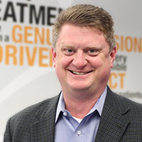 Headshot of Airrosti Senior Vice President of Practice Operations with text in the background
