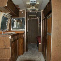 Oak Kitchen Pantry Black Table Set 1973 Airstream Overlander 27' - Minnesota