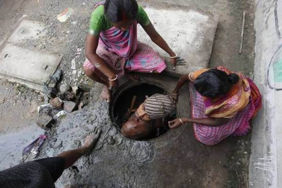 Sanitation Workers forced in manual scavenging