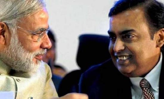 Modi (left ) and Ambani (right)