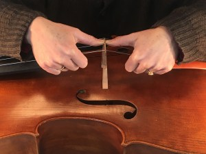 Robin Aitchison straightens cello bridges like this