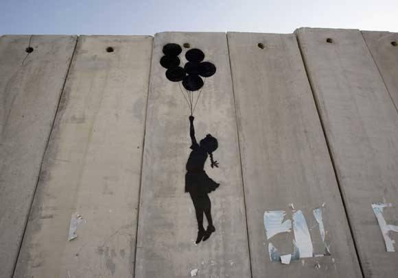 muro palestina israele banksy