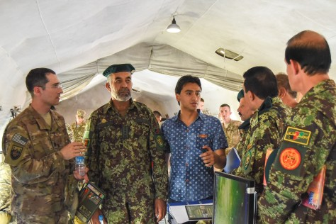 KAZAKHSTAN – Air Force Capt. Adam Howland (left) assigned to the Combined Security Assistance Command-Afghanistan, discusses the differences between peacekeeping and wartime operations with leaders of the Afghan army during phase two of Steppe Eagle 15, June 21, at Illisky Training Area. Soldiers from eight countries are participating in a command post exercise focused on staff planning using the Military Decision Making Process. (U.S. Army photo by Maj. Angel Jackson, U.S. Army Central PAO)