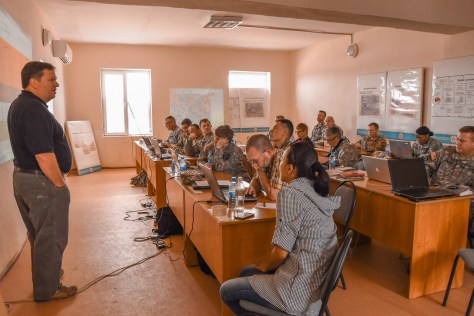 KAZAKHSTAN – U.S. Army Central Soldiers and civilians along with members of the Kazakhstani army discuss Steppe Eagle 15 exercise scenarios, June 21, at Illisky Training Area. Soldiers from eight countries, participated in the command post exercise focused on staff planning using the Military Decision Making Process. In its thirteenth iteration, Steppe Eagle provides multilateral forces with the opportunity to promote cooperation among participating forces, practice crisis management, and enhance readiness through realistic, modern-day interactive scenarios. (U.S. Army photo by Maj. Angel Jackson, U.S. Army Central PAO)