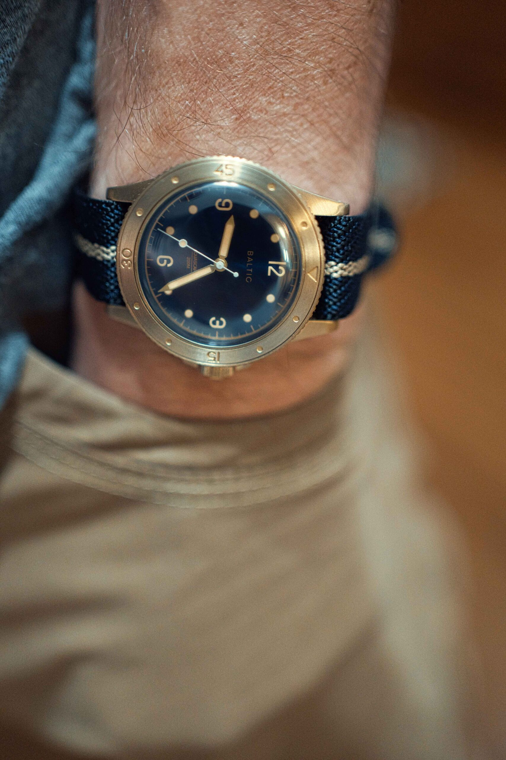 wrist shot of the baltic bronze on a crown and budle strap