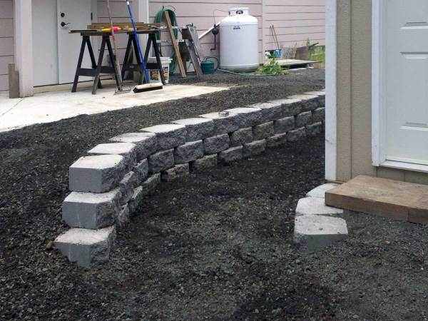 small retaining wall protects
