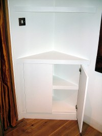 Triangular corner cupboard with floating shelves by ...