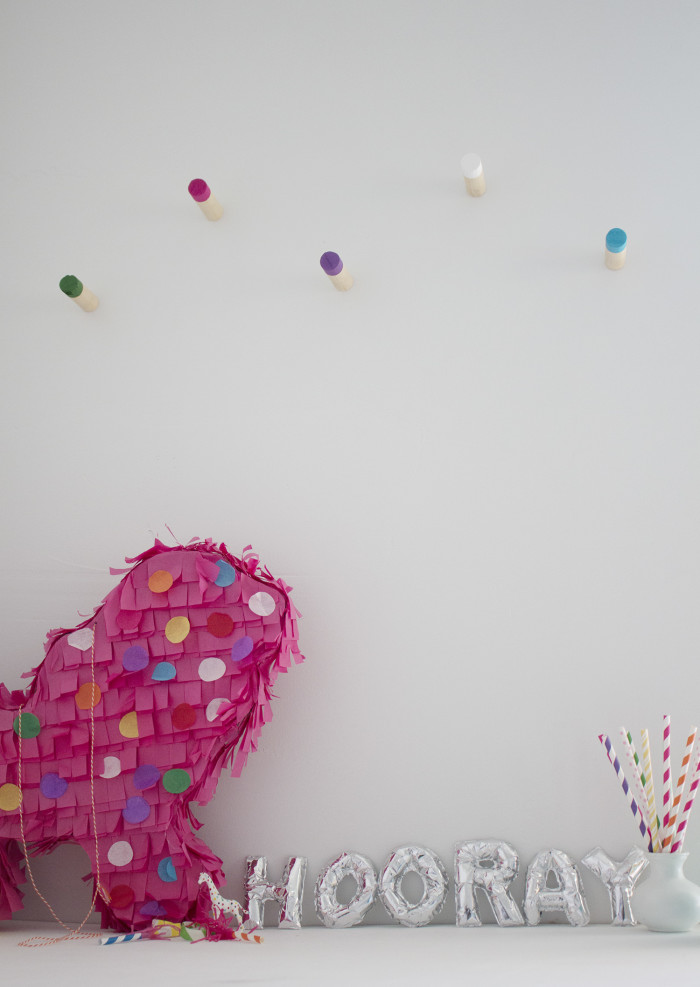 Simple, colorful wood wall hooks via A Joyful Riot