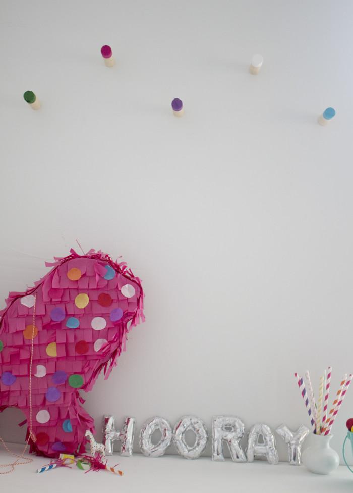 Cute colorful craft corner with DIY wood wall hooks | A Joyful Riot