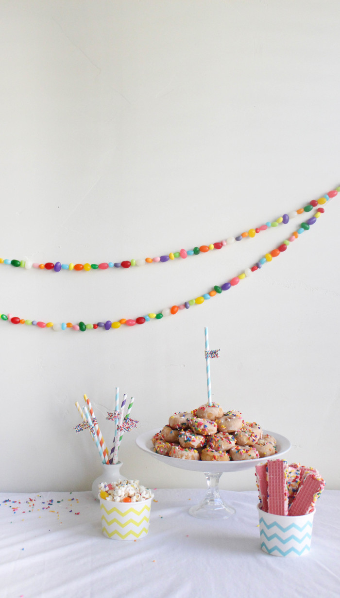 Threading jellybeans makes for a super cute decor item this Easter! | A Joyful Riot