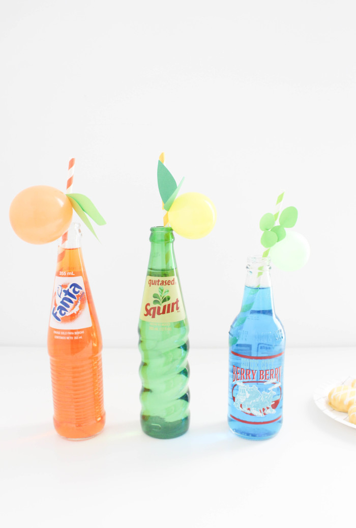 Sweet and colorful fruit balloon straws for your summer parties! Lemons, limes, pineapples, strawberries, cherries, peach, orange, grapes, blueberries! via A Joyful Riot-1