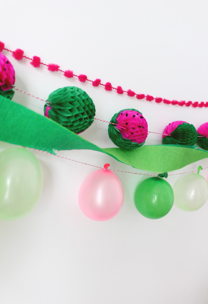 Little honeycomb balls that look like watermelons. String up as a garland for cute decor! | A Joyful Riot