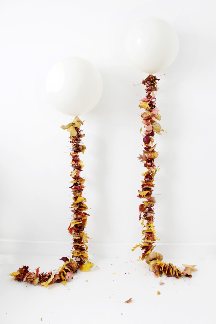 diy leaf garlands to hang from geronimo balloons. A pretty, autumn twist on the usual tassels! ajoyfulriot.com @ajoyfulriot