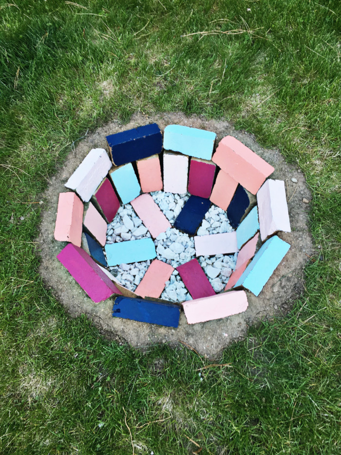 Build your own colorful brick fire pit in your backyard via ajoyfulriot.com