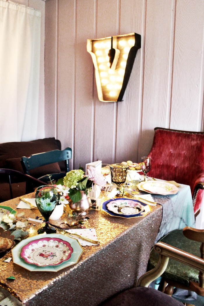 vintage armchairs and mixed plates and stem ware