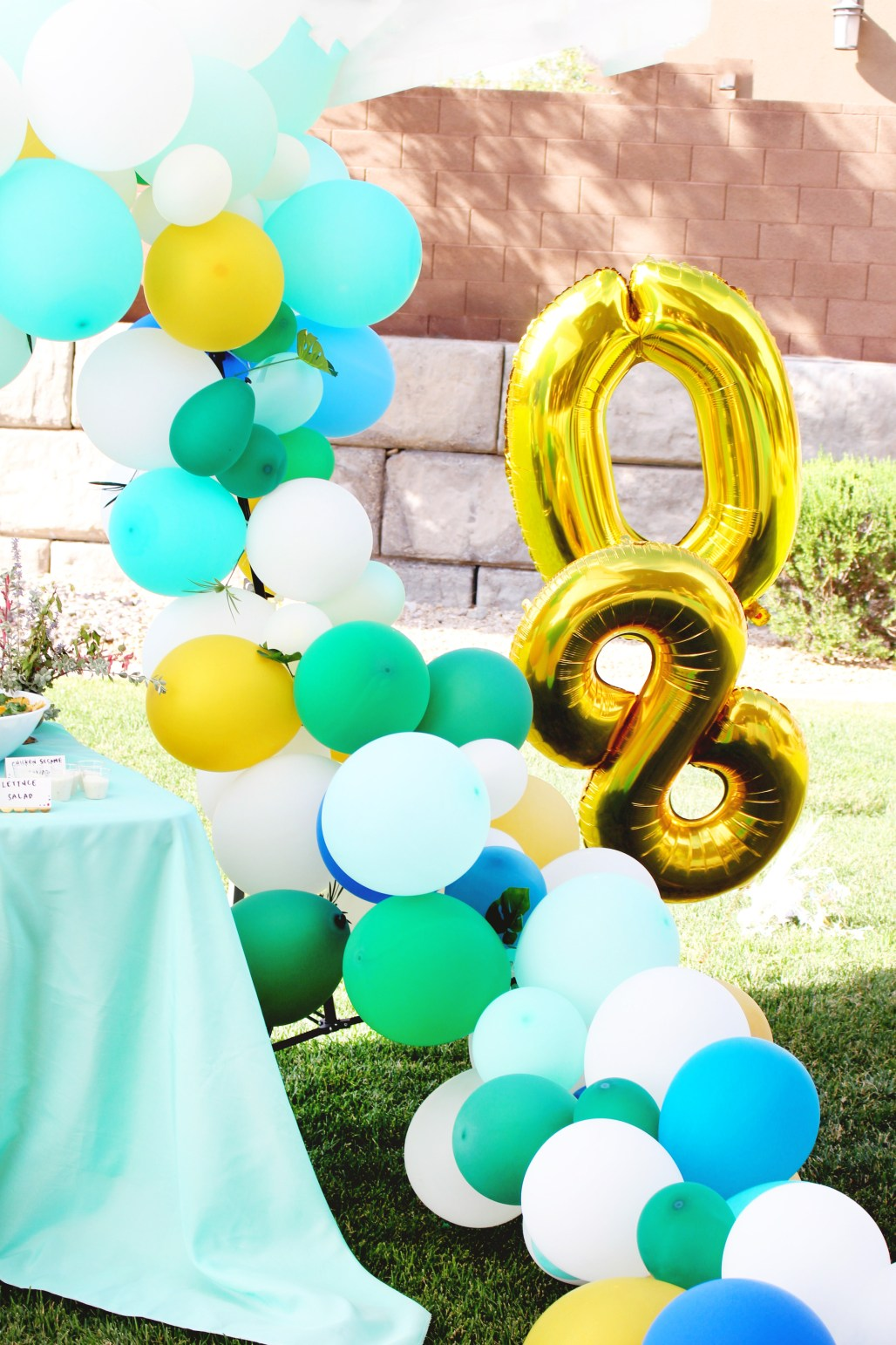 Modern Tropical 80th Birthday Party gold number balloon arch