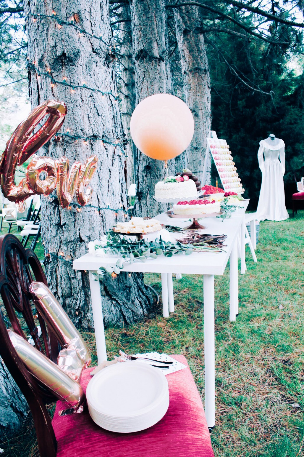 pink and rose gold bridal shower dessert table, copper balloons, grandmas wedding dress display