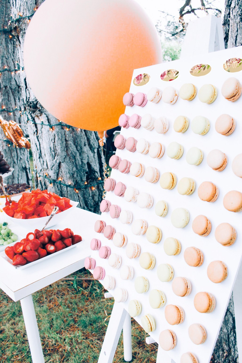 Easy DIY french macaron wall at a pink and rose gold bridal shower