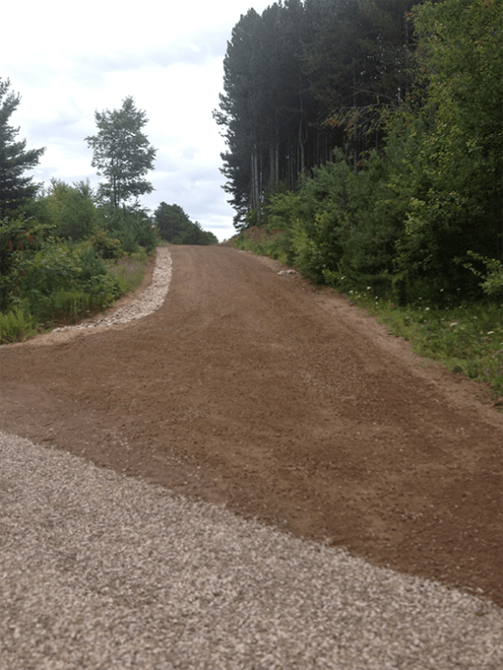 Gravel grade with spillways