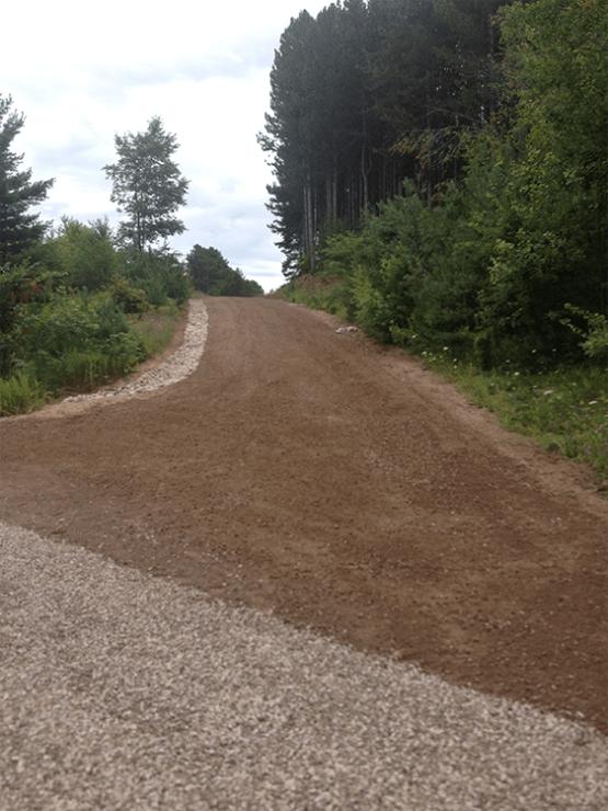 Gravel grade with spillways
