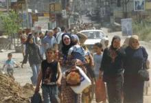 صورة الف فلسطيني يدخلون لبنان بعد القتال في دمشق