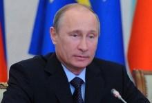 صورة بوتين: استخدام القوة لحل الأزمة السورية مصيره الفشل
