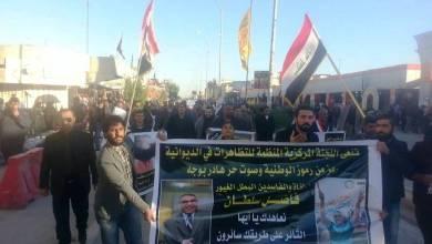 """صورة """" جمعة فاضل سلطان"""" في الديوانية تطالب بإصلاح القضاء ومتظاهرون يتهمون الحكومة بوفاته"""