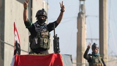 صورة تحرير حي الاندلس بالساحل الايسر للموصل ورفع العلم العراقي فوق مبانيه