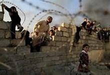 صورة داعش يجبر اطفال الموصل على نقل المواد المتفجرة
