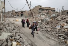 صورة الدفاع المدني يؤكد وجود ثلاثة الاف جثة تحت الانقاض في الموصل